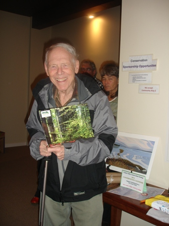 Peter Chandle accepting the Comox Valley Conservation Calendar door prize