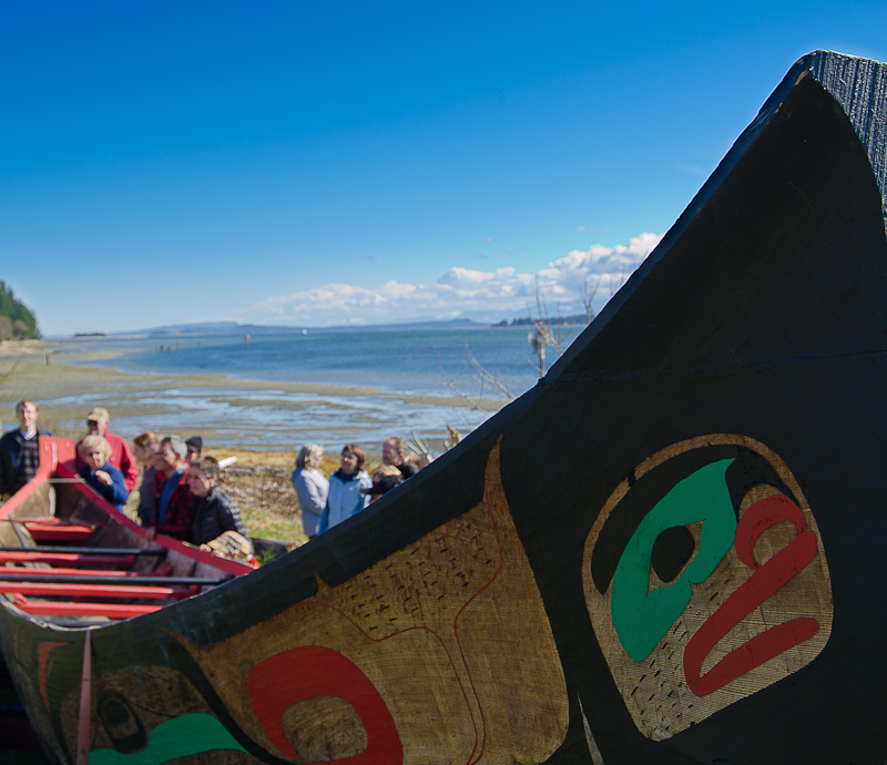 Visitors admire K'omoks First Nation Canoe. Photo by Dylan Miles