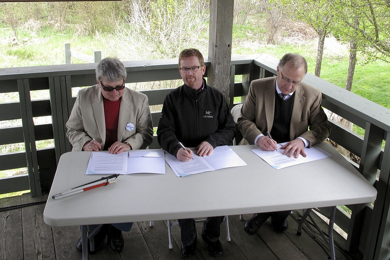 "(Left to right): Project Watershed's Dr. Paul Horgen, Minister of Environment Hon. Terry Lake and VIU President Dr. Ralph Nilson signed a three way Memorandum of Understanding between the University, Project Watershed and the BC Government (via, Ministry of Environment and the Climate Action Secretariat to work together to investigate ""Blue Carbon"" and its role of estuaries in sequestering carbon."