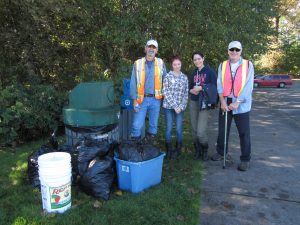 Some of the 2014 cleanup crew stand beside their garbage haul.